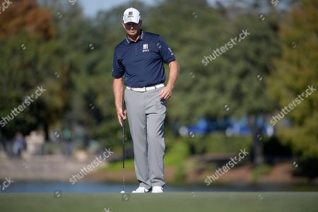 Stock Picture of Retief Goosen lines up his putt on the 18th green during the first round of the Father Son Challenge golf tournament, in Orlando, Fla