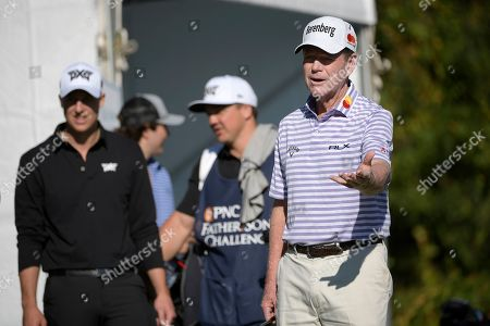 Tom Watson, right, jokes with Jack Nicklaus while waiting to tee off on the first hole during the first round of the Father Son Challenge golf tournament, in Orlando, Fla