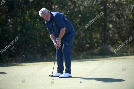 Darren Clarke watches his putt on the seventh green during the first round of the Father Son Challenge golf tournament, in Orlando, Fla