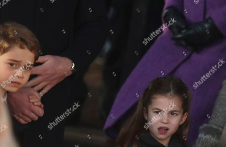 Britain's Prince George and Princess Charlotte, children of the Duke and Duchess of Cambridge after attending a Christmas day service at the St Mary Magdalene Church in Sandringham in Norfolk, England