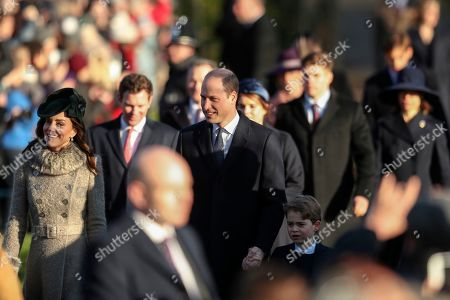 Britain's Prince William, center, and Kate, Duchess of Cambridge, left, arrive with their son Prince George, center right, to attend the Christmas day service at St Mary Magdalene Church in Sandringham in Norfolk, England