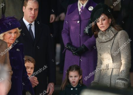 Britain's Prince William, Duke of Cambridge, second left, Catherine, Duchess of Cambridge, right, and their children Prince George and Princess Charlotte arrive to attend the Christmas day service at St Mary Magdalene Church in Sandringham in Norfolk, England