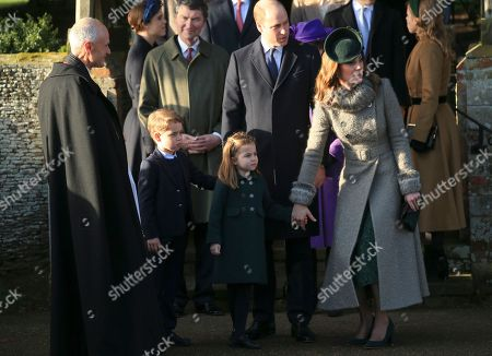 Britain's Prince William, Duke of Cambridge and Catherine, Duchess of Cambridge stand with their children Prince George and Princess Charlotte outside the St Mary Magdalene Church in Sandringham in Norfolk, England