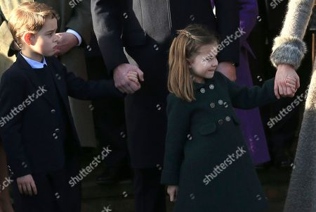 Britain's Prince William, Duke of Cambridge and Catherine, Duchess of Cambridge hold the hands of their children Prince George and Princess Charlotte after attending a Christmas day service at the St Mary Magdalene Church in Sandringham in Norfolk, England