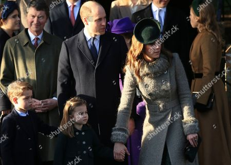 Britain's Prince William, Duke of Cambridge and Catherine, Duchess of Cambridge stand with their children Prince George and Princess Charlotte after attending a Christmas day service at the St Mary Magdalene Church in Sandringham in Norfolk, England