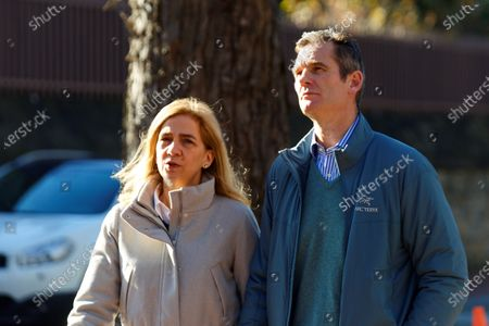Spanish Infanta Cristina (L) and his husband Inaki Urdangarin (R) walk in Vitoria, northern Spain, 25 December 2019. Urdangarin and his family take advantage of his first four-day prison permit. The brother-in-law of the Spain's King Felipe VI is serving a sentence of five years and 10 months in prsion for prevarication and public administration fraud.