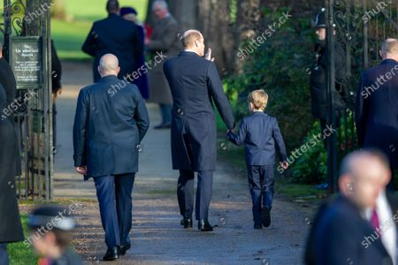 Prince William with Prince George at the Christmas Day morning church service at St Mary Magdalene Church