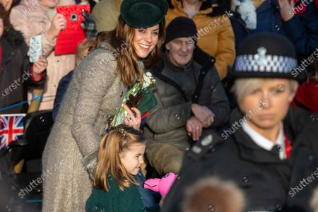 Catherine Duchess of Cambridge and Princess Charlotte at the Christmas Day morning church service at St Mary Magdalene Church