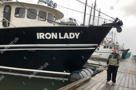 Stock Image of Kevin Dunn, a trawler who fishes for groundfish, stands next to his boat as he speaks on the phone with a fish processor at the docks in Warrenton, Oregon. A rare environmental success story is unfolding in waters off the U.S. West Coast as regulators in January 2020 are scheduled to reopen a large area off the coasts of Oregon and California to groundfish bottom trawling fishing less than two decades after authorities closed huge stretches of the Pacific Ocean due to the species' depletion