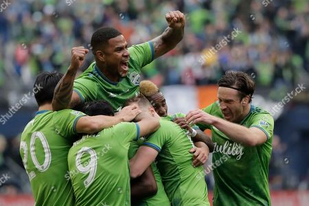 Seattle Sounders defender Roman Torres holds up his arms as he celebrates with teammates after defender Kelvin Leerdam scored a deflected goal against Toronto FC during the second half of the MLS Cup championship soccer match in Seattle. Seattle's championship victory was among Washington state's top news stories of 2019