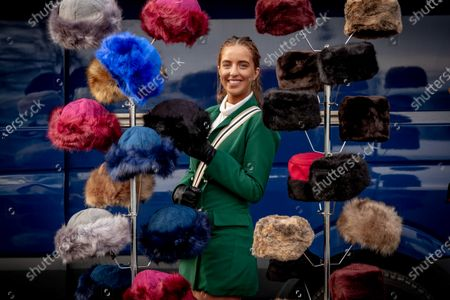 Stock Picture of Hannah Mulholland from Rathfarnham browses the hats on sale at Leopardstown