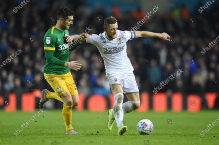 Liam Cooper of Leeds United is challenged by David Nugent of Preston North End.