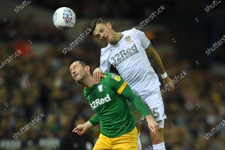 Stock Photo of Ben White of Leeds United is challenged by David Nugent of Preston North End.