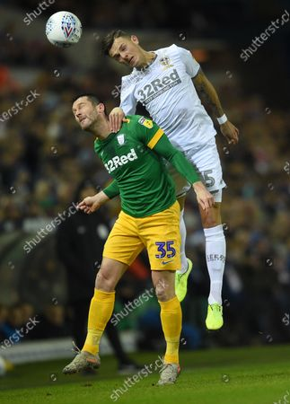 Ben White of Leeds United is challenged by David Nugent of Preston North End.