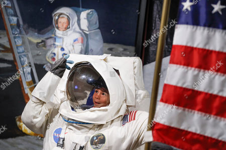 Fisitors pose for photos beside a portrait of Neil Armstrong at the Armstrong Air and Space Museum as special events are underway for visitors commemorating the 50th anniversary of the first moon landing in Wapakoneta, Ohio. A mass shooting that left nine dead in Dayton is among Ohio's top stories for 2019 as selected by The Associated Press. Other big stories this past year in Ohio include the closing of a massive auto plant near Youngstown and the investigation of a Columbus doctor accused of ordering painkillers for dozens of patients who then died. Also making the list are the signing of a restrictive abortion bill, a lawsuit involving the nation's biggest drug distributors, an outbreak of tornadoes near Dayton and Ohio State's undefeated run to the college football playoffs