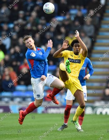 Andy Cannon (14) of Portsmouth battles for possession with Sido Jombati (2) of Wycombe Wanderers during the EFL Sky Bet League 1 match between Portsmouth and Wycombe Wanderers at Fratton Park, Portsmouth