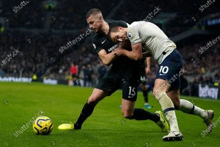 Tottenham's Harry Kane (R) vies for the ball against Brighton's Adam Webster (L) during the English Premier League soccer match between Tottenham Hotspur and Brighton & Hove Albion in London, Britain, 26 December 2019.