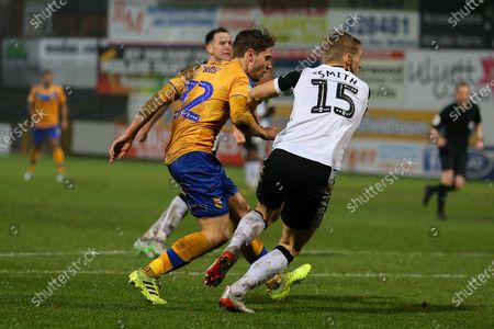 Mansfield Town forward Danny Rose (32) shoots at goal during the EFL Sky Bet League 2 match between Mansfield Town and Port Vale at the One Call Stadium, Mansfield