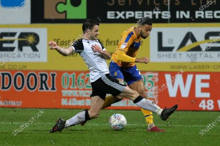 Mansfield Town forward Danny Rose (32) takes on the Port Vale defender during the EFL Sky Bet League 2 match between Mansfield Town and Port Vale at the One Call Stadium, Mansfield