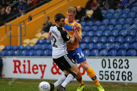 Mansfield Town midfielder Willem Tomlinson (16) challenges Port Vale defender James Gbbons (2) during the EFL Sky Bet League 2 match between Mansfield Town and Port Vale at the One Call Stadium, Mansfield