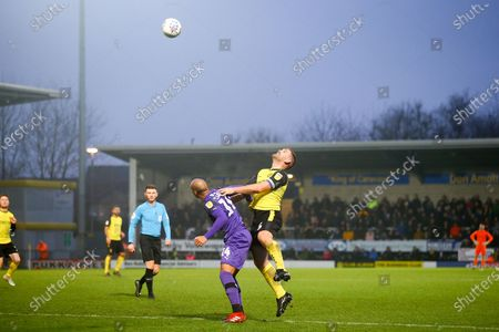Jake Buxton of Burton Albion (5) gets above Jake Caprice of Tranmere Rovers (14) during the EFL Sky Bet League 1 match between Burton Albion and Tranmere Rovers at the Pirelli Stadium, Burton upon Trent