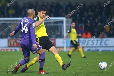 Scott Fraser of Burton Albion (8) and Jake Caprice of Tranmere Rovers (14) during the EFL Sky Bet League 1 match between Burton Albion and Tranmere Rovers at the Pirelli Stadium, Burton upon Trent