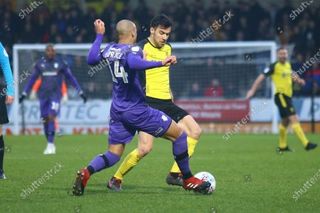 Jake Caprice of Tranmere Rovers (14) tackles Scott Fraser of Burton Albion (8) during the EFL Sky Bet League 1 match between Burton Albion and Tranmere Rovers at the Pirelli Stadium, Burton upon Trent