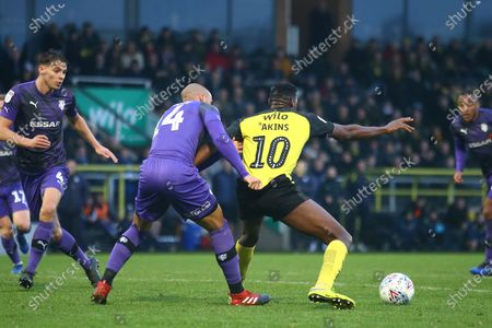 Lucas Akins of Burton Albion (10) has his shirt tugged by Jake Caprice of Tranmere Rovers (14) during the EFL Sky Bet League 1 match between Burton Albion and Tranmere Rovers at the Pirelli Stadium, Burton upon Trent