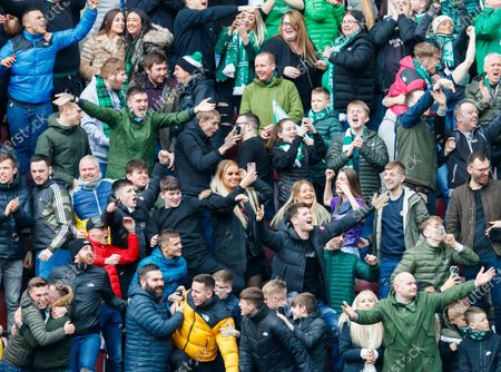 Hibernian fan Jane Park (centre) films Hearts fans on her pink covered mobile phone after Martin Boyle of Hibernian scored to give them a 2-0 lead.