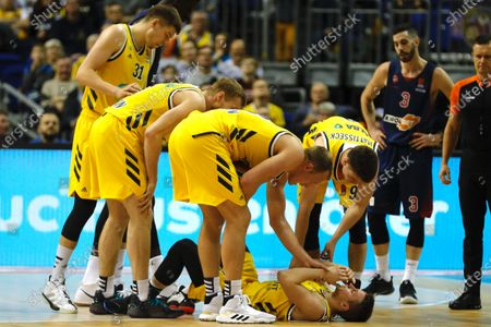 Alba Berlin's Makai Mason lies on the ground after an injury, during the Euroleague basketball match between Alba Berlin vs Saski Baskonia at the Mercedes Benz Arena in Berlin, Germany, 26 December 2019.