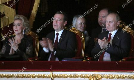 Stock Photo of Russian Prime Minister Dmitry Medvedev (front C), his wife Svetlana Medvedeva (front L) and Russian President Vladimir Putin (front R) attend a New Year gala event at the Bolshoi Theater in Moscow, Russia, 26 December 2019.