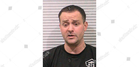 This undated booking photo provided by the Cache County Sheriff's Office shows Peter Ambrose, 34, of Smithfield, Utah. Authorities say Ambrose, vandalized a Church of Jesus Christ of Latter-day Saints temple because he was upset no women from the faith would date him and he has been charged with burglary and criminal mischief
