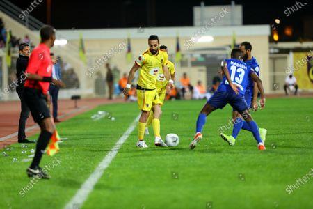 Stock Image of Al-Hazm's Abdullah Haif Al-Shammari (L) in action against Al-Hilal's Hassan Kadash (C) And Al-HILAL's Abdullah Otayf (R) during the Saudi Professional League soccer match between al-Hazm and al-Hilal at al-Hazm Club Stadium, Ar Rass, Saudi Arabia, 26 December 2019.