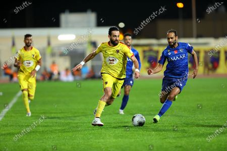 Al-Hazm's Abdullah Haif Al-Shammari (L) in action against Al-Hilal's Abdullah Otayf (R) during the Saudi Professional League soccer match between al-Hazm and al-Hilal at al-Hazm Club Stadium, Ar Rass, Saudi Arabia, 26 December 2019.