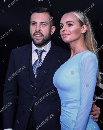 Barcelona's Jordi Alba and his wife Romarey Ventura pose during the vows renewal ceremony of the Uruguayan Luis Suarez and his wife Sofia Balbi, in Montevideo, Uruguay, 26 December 2019.