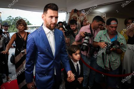 Barcelona soccer player Lionel Messi and his son attend the vows renewal ceremony of the Uruguayan Luis Suarez and his wife Sofia Balbi, in Montevideo, Uruguay, 26 December 2019.