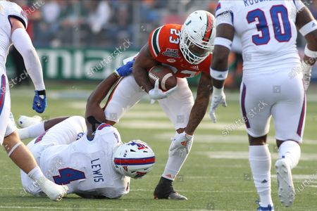 , 2019, Shreveport, Louisiana, USA: College Football Miami Hurricanes running back Cam'Ron Harris (23) being tackled by Louisiana Tech Bulldogs safety Darryl Lewis (4) during the first half of the Independence Bowl at the Independence Stadium in Shreveport, Louisiana on December 26, 2019. ©Justin Manning/Eclipse Sportswire/CSM
