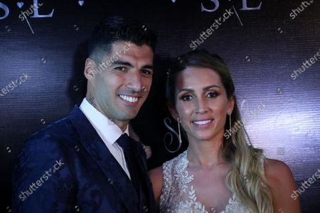 Stock Image of FC Barcelona's Uruguayan soccer player Luis Suarez (L) and his wife Sofia Balbi (R) pose during a ceremony to renew their marriage vows, in Montevideo, Uruguay, 26 December 2019.