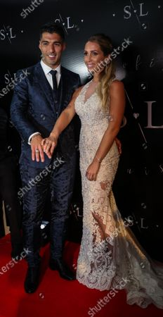 Stock Photo of FC Barcelona's Uruguayan soccer player Luis Suarez (L) poses with his wife Sofia Balbi (R) during a ceremony to renew their marriage vows, in Montevideo, Uruguay, 26 December 2019.