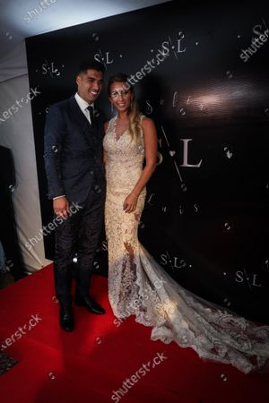 FC Barcelona's Uruguayan soccer player Luis Suarez (L) poses with his wife Sofia Balbi (R) during a ceremony to renew their marriage vows, in Montevideo, Uruguay, 26 December 2019.