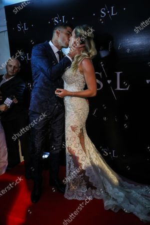 FC Barcelona's Uruguayan soccer player Luis Suarez (L) kisses his wife Sofia Balbi (R) during a ceremony to renew their marriage vows, in Montevideo, Uruguay, 26 December 2019.
