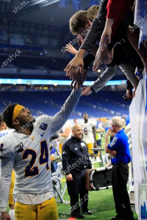 Pittsburgh Panthers linebacker Phil Campbell III (24) high fives the fans after the game as he makes his way into the locker room tunnel at the NCAA Quick Lane Bowl game between the Eastern Michigan Eagles and the Pittsburgh Panthers at Ford Field in Detroit, Michigan
