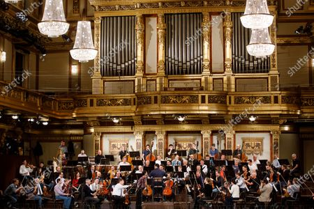 The orchestra led by Latvian conductor Andris Nelsons (C) performs during a rehearsal of the Wiener Philharmoniker (Vienna Philharmonic) New Year's Concert 2020 at the Musikverein Concert Hall in Vienna, Austria, 27 December 2019. The traditional concert is staged every year on 01 January
