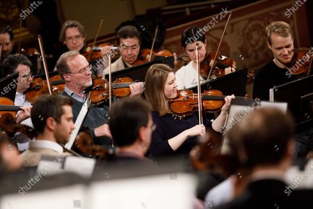 Violin players led by Latvian conductor Andris Nelsons (unseen) perform during a rehearsal of the Wiener Philharmoniker (Vienna Philharmonic) New Year's Concert 2020 at the Musikverein Concert Hall in Vienna, Austria, 27 December 2019. The traditional concert is staged every year on 01 January
