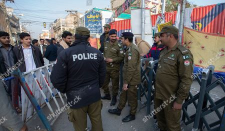 Pakistani police cordon off the area during a gathering in Rawalpindi, Pakistan, to observe the death anniversary of Bhutto in Pakistan. Former Prime Minister of Pakistan Benazir Bhutto was assassinated in Rawalpindi in 2007