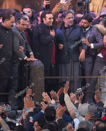 Bilawal Bhutto, center, leader of Pakistan People's party greets his supporters gather in Rawalpindi, Pakistan, to observe the death anniversary of his mother Benazir Bhutto in Pakistan. Former Prime Minister of Pakistan Benazir Bhutto was assassinated in Rawalpindi in 2007