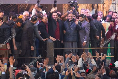 Bilawal Bhutto, center, leader of Pakistan People's party waves to his supporters gather in Rawalpindi, Pakistan, to observe the death anniversary of his mother Benazir Bhutto in Pakistan. Former Prime Minister of Pakistan Benazir Bhutto was assassinated in Rawalpindi in 2007