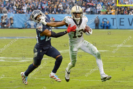 Shows New Orleans Saints wide receiver Michael Thomas (13) pushing past Tennessee Titans cornerback Logan Ryan (26) after Thomas makes a reception in the second half of an NFL football game in Nashville, Tenn. The catch gave Thomas the single-season pass reception record. Regardless of the record stream of receptions by Thomas, the sacks by Chandler Jones and lengthy field goals by nearly every placekicker, the headlines regularly were about referees and field judges