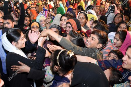 Asifa Bhutto Zardari (L) daughter of former prime minister Benazir Bhutto greets supporters, as Bilawal Bhutto Zardari Chairman of Pakistan People Party (PPP) speaks in Rawalpindi, during the Benazir Bhutto's 12th death anniversary of her assassination in Gari Khuda Buksh, Pakistan, 27 December 2019. Bhutto was killed in an attack during an election campaign in Rawalpindi on 27 December 2007.