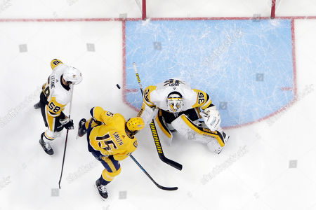 Craig Smith, Kris Letang, Tristan Jarry. Nashville Predators right wing Craig Smith (15) scores a goal against Pittsburgh Penguins goaltender Tristan Jarry (35) during the first period of an NHL hockey game, in Nashville, Tenn. At left is Penguins defenseman Kris Letang